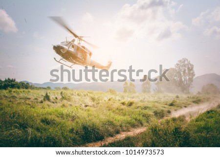 Military helicopter flying in the sky over the field,copy space.