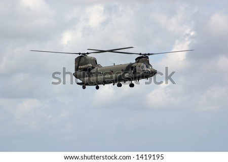 Military helicopter flying to pick up sandbags during flooding in the aftermath of Hurricane Katrina and Rita in New Orleans.
