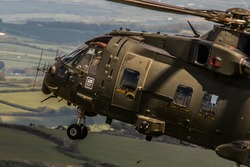 Military Helicopter Merlin EH101 flying on a training mission.