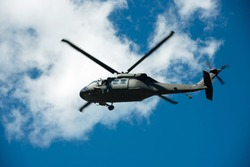 Military helicopter to the battlefield. Black Hawk flies in the blue sky. thai Black Hawk helicopter