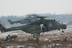 Military helicopters operating in winter and snow conditions