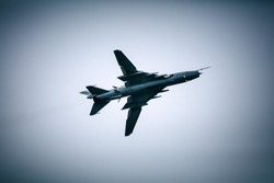 Military jet fighter flying in the cloudy sky. Army airforce