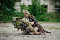 Military Man Hugs Dog