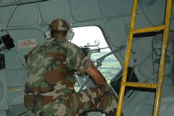 Military man in helicopter in the air