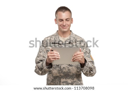 Military Man looking at a computer tablet