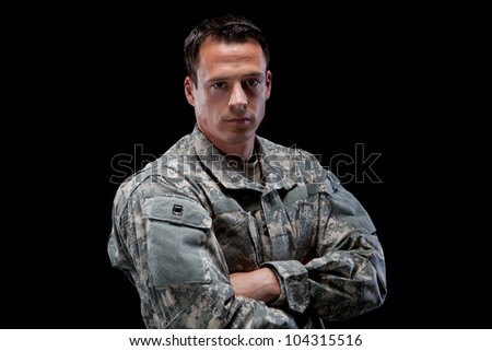 Military man with his arms crossed