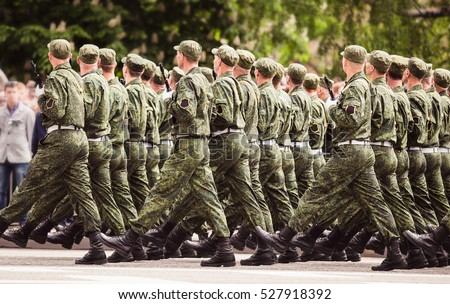 military men marching to victory parade