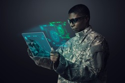 Military officer using transparent tablet army technology