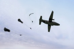 Military parachutist on the background of blue sky. Rangers parachuted from military airplanes. Soldiers parachuted from the plane.