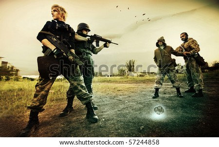 Military patrol in Chernobyl (man and blond woman) is stopping two stalkers on the road