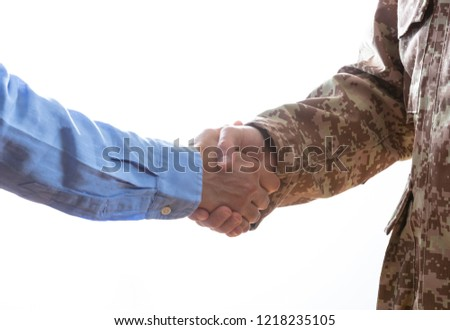 Military person and civilian shaking hands standing on white background ストックフォト ©