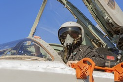 Military pilot in the cockpit of a jet aircraft Su-24