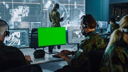 Military Surveillance Officer Working on Computer with Green Screen in Central Office for Cyber Operations, Control and Monitoring for Managing National Security, Technology and Army Communications.
