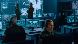 Military Surveillance Team of Officers Locked a Target on a Vehicle from a Satellite and Monitor it on a Big Display in Office for Cyber Operations for Managing Security and Army Communications.