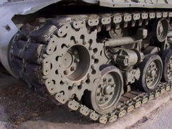 Military tank track and gears close-up
