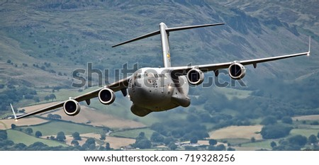 Military transport aircraft flying low level