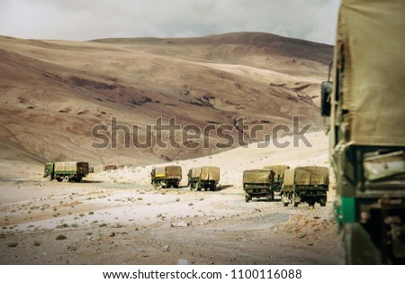 Military Truck Convoy on the high mountain Leh - Manali highway on Jammu and Kashmir, Nothern India