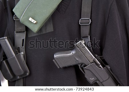 Military uniform, cap, pistol, ammo clip, and holster