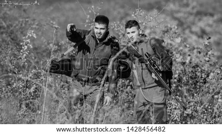 Military uniform fashion. Hunting skills and weapon equipment. How turn hunting into hobby. Friendship of men hunters. Man hunters with rifle gun. Boot camp. Army forces. Camouflage. follow this way.
