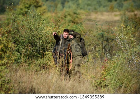 Military uniform. Hunting skills and weapon equipment. How turn hunting into hobby. Friendship of men hunters. Man hunters with rifle gun. Boot camp. Army forces. Camouflage. Hunter observing forest.