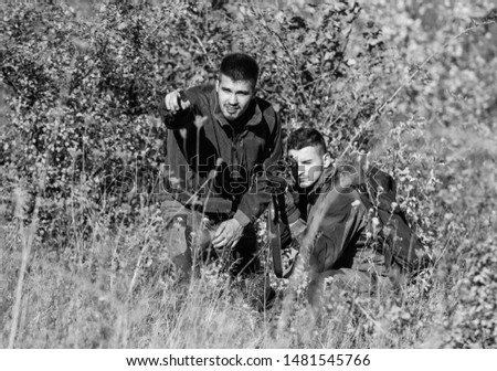 Military uniform. Hunting skills and weapon equipment. How turn hunting into hobby. Friendship of men hunters. Man hunters with rifle gun. Boot camp. Army forces. Camouflage. Regulation of hunting.