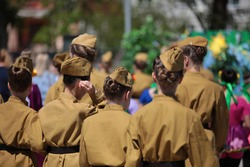 Military woman.A group of young slender girls in military uniform in a khaki tunic and with long dark hair gathered in a hairstyle in a garrison cap on their head.Photo female cadet back view