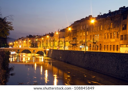 Miljacka river in Sarajevo the capital city of Bosnia and Herzegovina, at dusk - stock photo