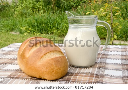 milk and bread on table in garden