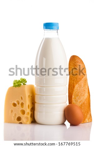 milk bottle cheese bread and egg isolated on white