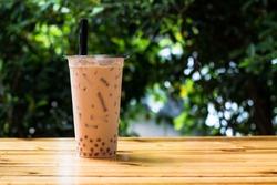 Milk bubble tea in takeaway glass