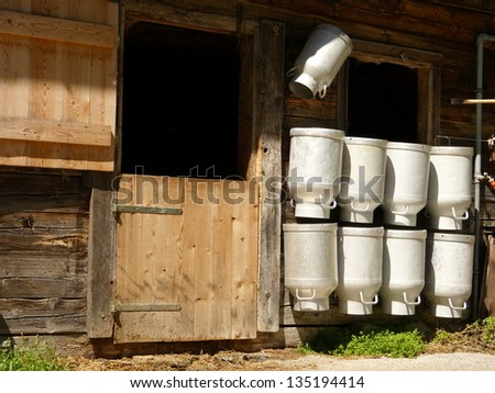 Milk cans on cowshed