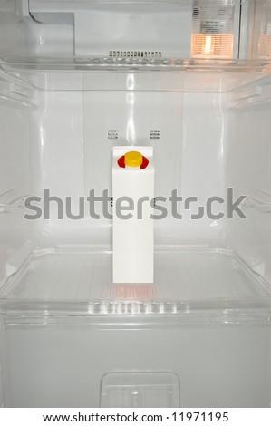 Milk carton inside a new refrigerator