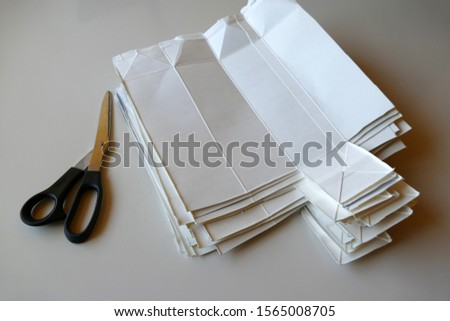 Milk cartons  opened for recycling. recycling and scissor
