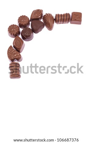 Milk chocolate candies isolated on white background