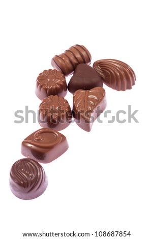 Milk chocolate confectionery candies isolated on white background