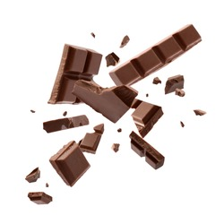 Milk chocolate explosion, pieces shattering on white background