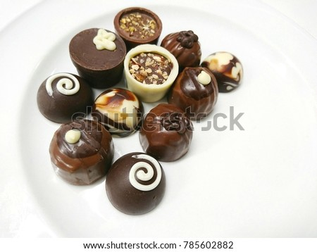 Milk chocolate in different designs and shapes  #785602882