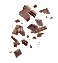 Milk chocolate pieces falling on white background