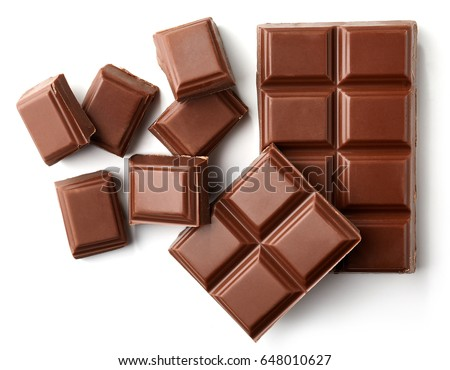 Milk chocolate pieces isolated on white background from top view #648010627