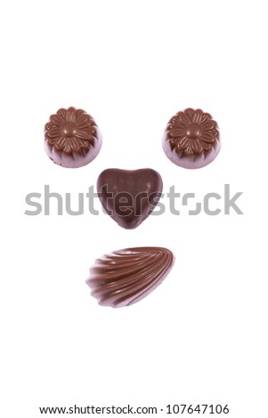 Milk chocolate smile candies isolated on white background