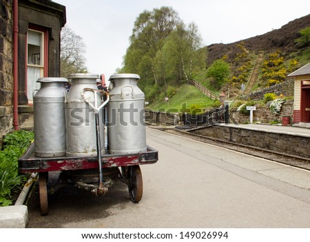 Milk churns at Goathland railway station, Yorkshire, England.