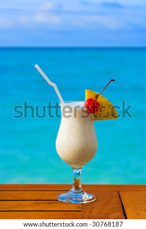 Milk cocktail on table at beach cafe - vacation background
