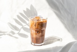 Milk cream iced coffee. Coffee cold brew drink cocktail with ice and milk.
