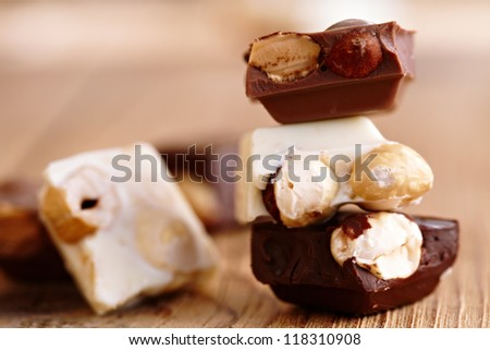 Milk, dark and white chocolate with nuts