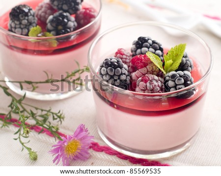Milk dessert with raspberry and blackberry. Selective focus