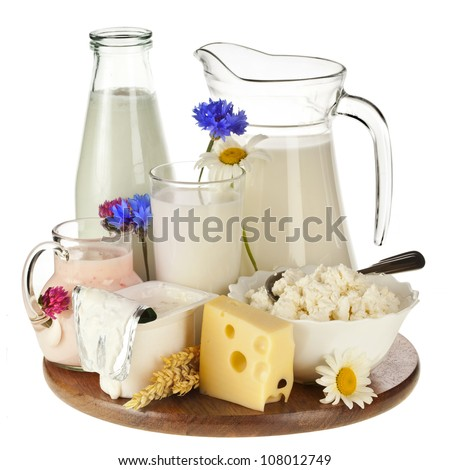 Milk in a glass on the wooden board isolated on white background