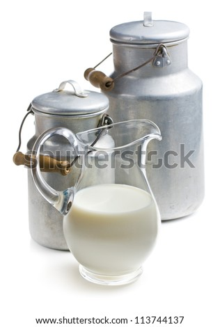 milk in a glass pitcher on white background