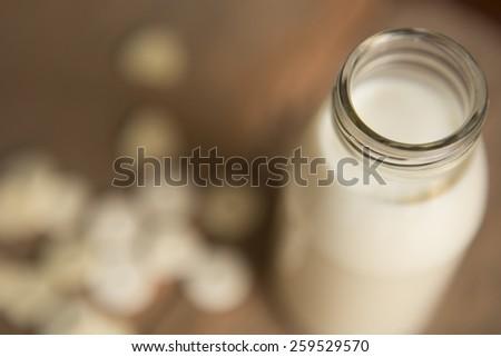 Milk in glass bottles with milk pellets Depth of Field style