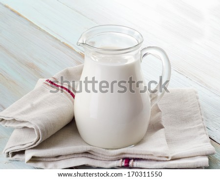 Milk  on wooden table. Selective focus