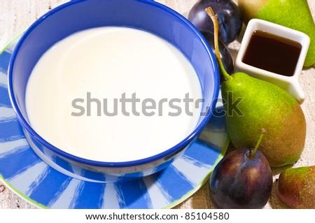 Milk or yoghurt in blue bowl